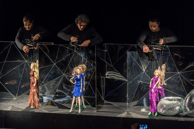 Marionettes present creations by Fause Haten during the Sao Paulo Fashion Week 2013 Summer collections, in Sao Paulo, Brazil. Real size collections are also showed after the show. (Yasuyoshi Chiba/Getty Images)