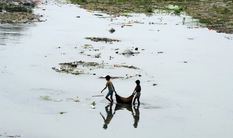 Indian children carry recyclable items from the polluted water of the Mahananda river in Siliguri. World Water Day calls for international attention on the impact of rapid urban growth, industrialization and uncertainties caused by climate change, conflicts, and natural disasters on urban water systems. India as a whole suffers from poor water management, with the country's most famous river, the holy Ganges, found to have 16 times the acceptable amount of coliform. A(Diptendu Dutta/Getty Images)
