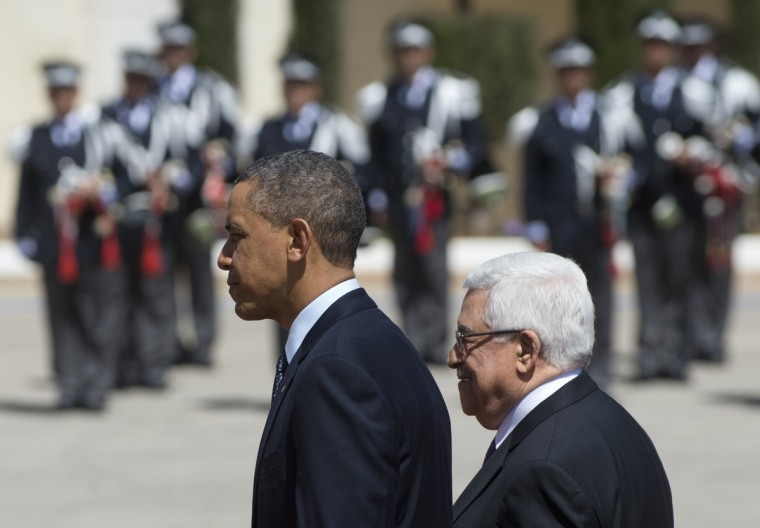 US President Barack Obama (L) and Palestinian president Mahmud Abbas review the honour guard during an official arrival ceremony at the Muqata, the Palestinian Authority headquarters in the West Bank city of Ramallah. Obama arrived in the West Bank city of Ramallah on his first visit since taking over the White House more than four years ago . (Saul Loeb/Getty Images)