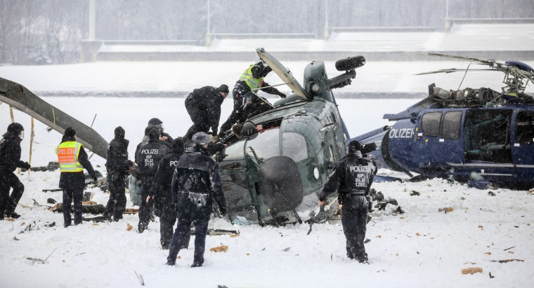 Police officers work at the scene where two police helicopters crashed near the Olympic stadium in Berlin. The helicopters crashed as they were landing after a training exercise. (Hannibal Hanschke/Getty Images)
