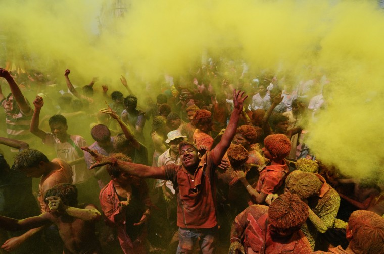 Indian revelers cover each other with colored powder during Holi festival celebrations in Guwahati. 'Holi', the Festival of Colours, is a popular Hindu spring festival observed in India and Nepal at the end of winter season on the last full moon day of the lunar month. (Biju Boro/Getty Images)