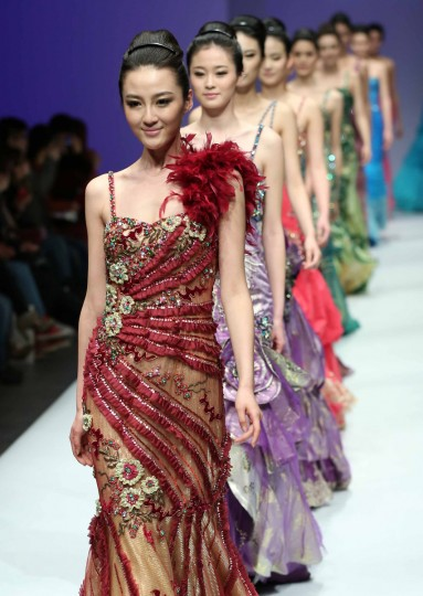 Models parade creations of Lu Classic Lu Weixing dress collection at the China Fashion Week in Beijing. Beijing Fashion Week began on March 25 with local and Asian designers now playing a major role in an event previously dominated by European fashion houses. (Getty Images)