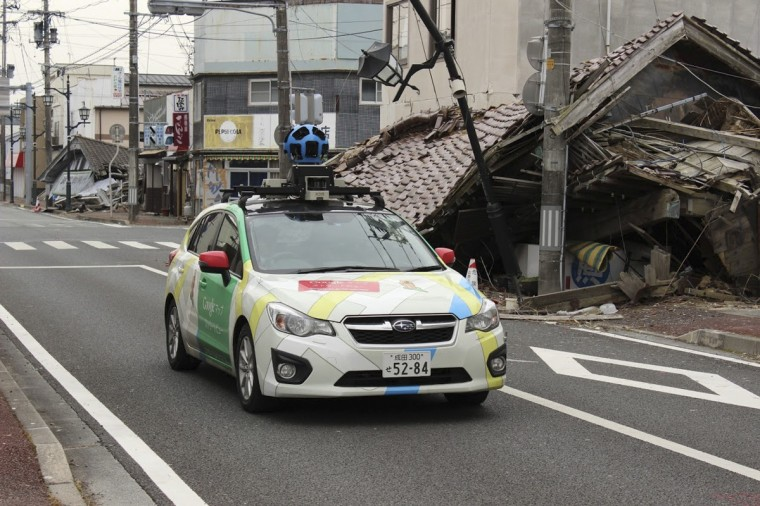 This undated handout photograph taken in March, 2013 by Google Street View and received on March 28, 2013 shows a Google car mounted with a street view camera as it drives through a street in Namie Town, Fukushima Prefecture. Google began offering the chance for people to wander virtually through an abandoned town deep within the exclusion zone around Japan's crippled nuclear plant. Visitors to the Internet giant's mapping site can take a tour through the overgrown and deserted streets of Namie, where time appears to have stood still for two years. (Google/via Getty Images)