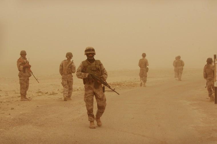 Soldiers from the 2nd Battalion of the Iraqi Ground Forces Command Patrol during a sandstorm August 8, 2005 in Fallujah, Iraq. The soldiers, with the help of U.S. Marine advisors, searched about 150 homes and took a census of the residents during the early-morning patrol in the northwest sector of the town. (Scott Olson/Getty Images)