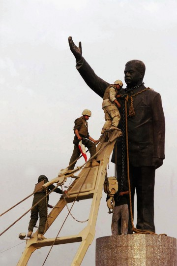 U.S marines climb up to topple a statue of Iraqi dictator Saddam Hussein on April 9, 2003 at al-Fardous square in Baghdad, Iraq.. The third year anniversary since the overthrow of Saddam Hussein will be marked on April 9, 2006 amidst continued unrest in Iraq, where over 30, 000 civilians have been reported to be killed since the start of the war. (Wathiq Khuzaie /Getty Images)
