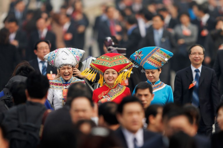 Delegates from the ethnic minorities walk from Tiananmen Square to the Great Hall of the People to attend a plenary session of the Chinese People's Political Consultative Conference during severe pollution on March 8, 2013 in Beijing, China. Clearing urban air pollution has become a big concern during the Chinese People's Political Consultative Conference. (Lintao Zhang/Getty Images)