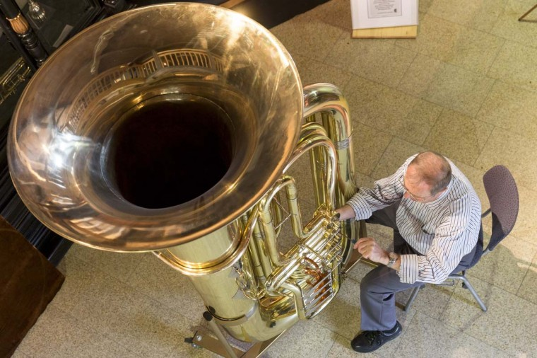Musical instrument craftsman Manfred Paulus adjusts the valves of world's largest functional tuba at the Musikinstrumenten-Museum on March 8, 2013 in Markneukirchen, Germany. The tuba is exactly double the dimensions in every respect to a normal tuba, and twenty local artisans crafted it in 2010 as part of celebrations around the town's 650th anniversary. (Joern Haufe/Getty Images)