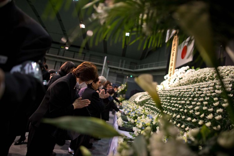 Japanese people pay their respect during a memorial ceremony to commemorate the victims of the 2011 earthquake and subsequent tsunami on March 11, 2013 in Kesennuma, Japan. Japan is commemorating the second anniversary of the 2011 Magnitude 9.0 earthquake and subsequent tsunami that claimed more than 18,000 lives. (Athit Perawongmetha/Getty Images)