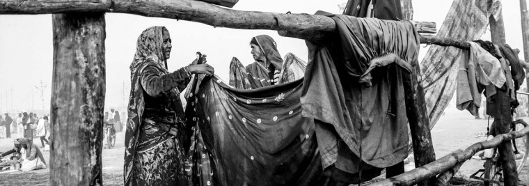 Hindu devotees hang out saris to dry after having bathed on the banks of Sangam on January 15, 2013 in Allahabad, India. (Daniel Berehulak/Getty Images)
