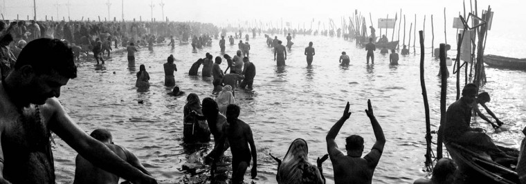 Hindu devotees bathe in the waters of Sangam, the confluence of the holy rivers Ganges, Yamuna and the mythical Saraswati, during the Maha Kumbh Mela on January 15, 2013 in Allahabad, India. (Daniel Berehulak/Getty Images)