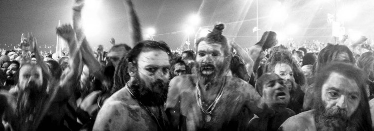 Naga Sadhus, naked Hindu holy men, walk in procession after having bathed on the banks of Sangam, the confluence of the holy rivers Ganges, Yamuna and the mythical Saraswati, on the auspicious bathing day of Mauni Amavasya during the Maha Kumbh Mela on February 10, 2013 in Allahabad, India. (Daniel Berehulak/Getty Images)