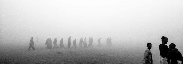 Hindu devotees walk through mist towards the banks of the holy Ganges river as people gather ahead of the Maha Kumbh Mela on January 13, 2013 in Allahabad, India. (Daniel Berehulak/Getty Images)