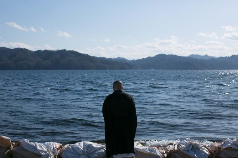 A Buddhist monk prays toward the sea on March 11, 2013 in Ootsuti, Iwate prefecture, Japan. On March 11 Japan commemorates the second anniversary of the magnitude 9.0 earthquake and tsunami that claimed more than 18,000 lives. (Ken Ishii/Getty Images)