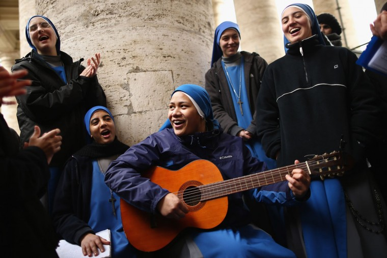 Nuns from the 'Instituto Serve del Signore, E Della Vergine Di Matara' sing hymns under the colonnade in St Peter's Square on March 12, 2013 in Vatican City, Vatican. Pope Benedict XVI's successor is being chosen by the College of Cardinals in Conclave in the Sistine Chapel. The 115 cardinal-electors, meeting in strict secrecy, will need to reach a two-thirds-plus-one vote majority to elect the 266th Pontiff. (Dan Kitwood/Getty Images)