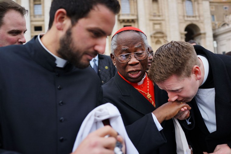 Cardinal Francis Arinze, 80, of Nigeria exits St Peter's Basilica after he attended the Pro Eligendo Romano Pontifice Mass before he and the other Cardinals will enter the conclave to decide who the next pope will be on March 12, 2013 in Vatican City, Vatican. Cardinals are set to enter the conclave to elect a successor to Pope Benedict XVI after he became the first pope in 600 years to resign from the role. The conclave is scheduled to start on March 12 inside the Sistine Chapel and will be attended by 115 cardinals as they vote to select the 266th Pope of the Catholic Church. (Spencer Platt/Getty Images)