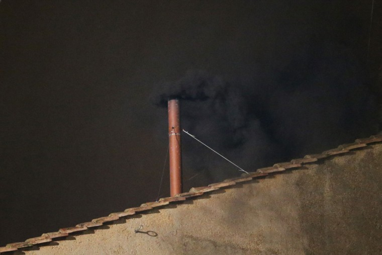 Black smoke billows out from a chimney on the roof of the Sistine Chapel indicating that the College of Cardinals have failed to elect a new Pope on March 12, 2013 in Vatican City, Vatican. (Peter Macdiarmid/Getty Images)