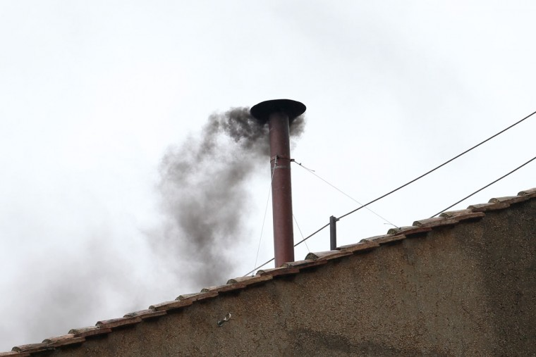 Black smoke billows out from a chimney on the roof of the Sistine Chapel, indicating that the College of Cardinals have failed to elect a new Pope in their morning voting session on March 13, 2013 in Vatican City, Vatican. Pope Benedict XVI's successor is being chosen by the cardinals in a papal conclave in the Sistine Chapel. The 115 cardinal-electors, meeting in strict secrecy, will need to reach a two-thirds-plus-one vote majority to elect the 266th Pontiff. (Peter Macdiarmid/Getty Images)