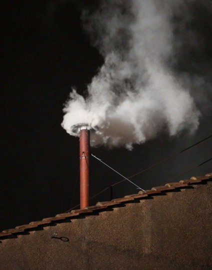 White smoke billows from the chimney on the roof of the Sistine Chapel indicating that the College of Cardinals have elected a new Pope on March 13, 2013 in Vatican City, Vatican. (Peter Macdiarmid/Getty Images)