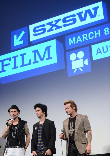 "Mike Dirnt, Billie Joe Armstrong and Tre Cool of Green Day speak on stage before the World Premiere of ""Broadway Idiot"" during the 2013 SXSW Music, Film + Interactive Festival at the Paramount Theatre on March 15, 2013 in Austin, Texas. (Michael Buckner/Getty Images for SXSW"