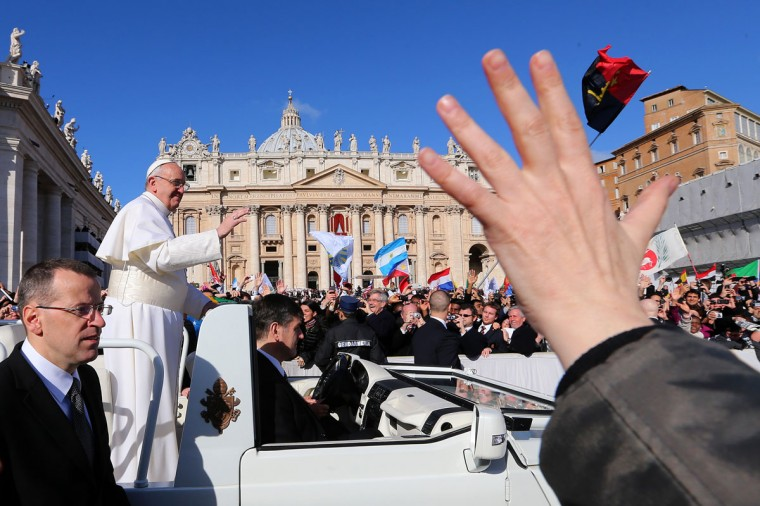 Pope Francis waves to the crowd as he arrives in the popemobile for his Inauguration Mass in St Peter's Square on March 19, 2013 in Vatican City, Vatican. The mass is being held in front of an expected crowd of up to one million pilgrims and faithful who have filled the square and the surrounding streets to see the former Cardinal of Buenos Aires officially take up his role as pontiff. (Joe Raedle/Getty Images)