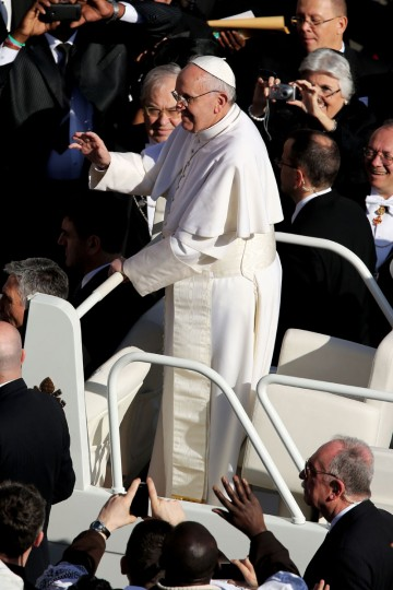 Pope Francis waves to the crowd as he arrives in the popemobile for his Inauguration Mass in St Peter's Square on March 19, 2013 in Vatican City, Vatican. (Dan Kitwood/Getty Images)
