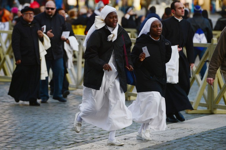 Pilgrims run into St. Peter's Square on March 19, 2013 in Vatican City, Vatican. (Jeff J Mitchell/Getty Images)