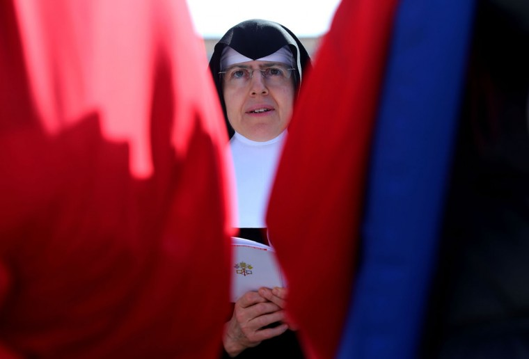 A nun prays during the inauguration mass for Pope Francis in St Peter's Square on March 19, 2013 in Vatican City, Vatican. (Joe Raedle/Getty Images)
