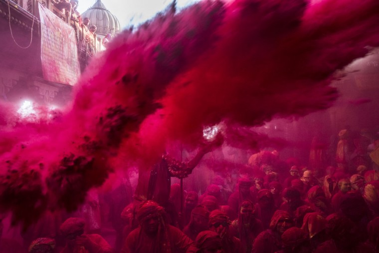 Hindu devotees play with color during Lathmar Holi celebrations on March 21, 2013 in the village of Barsana, near Mathura, India. (Daniel Berehulak/Getty Images)