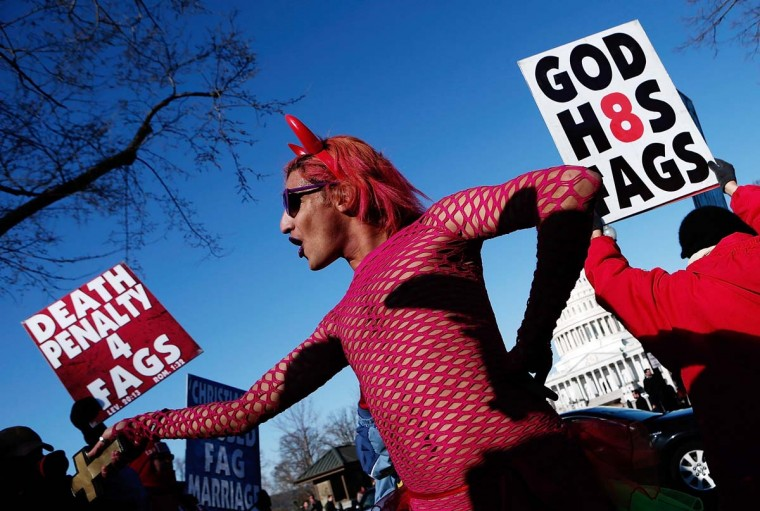 New York based drag performer Queen dances during a rally while surrounded by protesters from the conservative Westboro Baptist Church in front of the U.S. Supreme Court on March 26, 2013 in Washington, DC. (Win McNamee/Getty Images)