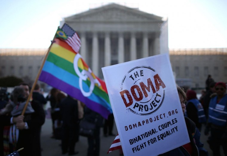 People carry banners and flags during a rally in front of the U.S. Supreme Court, on March 27, 2013 in Washington, DC. (Mark Wilson/Getty Images)