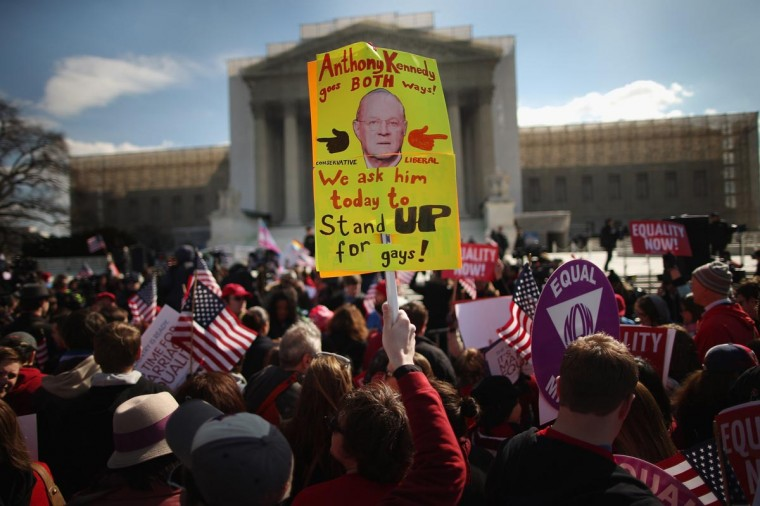 A sign depicting Associate Justice Anthony Kennedy is hoisted during a rally outside the Supreme Court during oral arguments in a case challenging the Defense of Marriage Act (DOMA) March 27, 2013 in Washington, DC. (Chip Somodevilla/Getty Images)