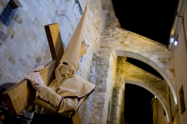 March 29, 2013: A penitent carries a cross during the Holy Week procession of the Cofradia Jesus Yacente in Zamora, Spain. (Pablo Blazquez Dominguez/Getty Images)