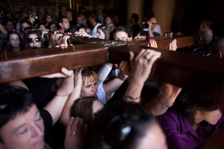 March 29, 2013: Christian worshipers carry a large wooden cross at the Church of the Holy Sepulchre during the Good Friday procession in Jerusalem's Old City, Israel. (Uriel Sinai/Getty Images)