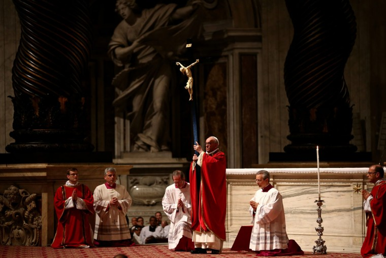 March 29, 2013: Pope Francis holds a crucifix aloft as he presides over a Papal Mass with the Celebration of the Lord's Passion inside St Peter's Basilica in Vatican City, Vatican. Pope Francis is taking part in his first holy week as pontiff and will later today preside over the Way Of the Cross procession at the Colosseum in Rome. (Dan Kitwood/Getty Images)