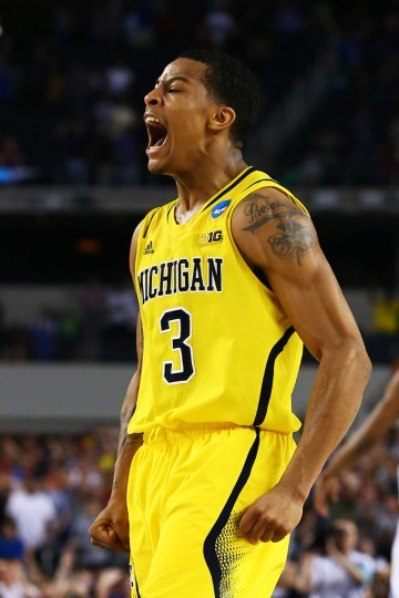Michigan's Trey Burke after shooting a game-tying three pointer in the final seconds of the second half against Kansas. Michigan went on to win their South Regional semifinal game in overtime on March 29, 2013 in Arlington, Texas. (Tom Pennington/Getty Images)