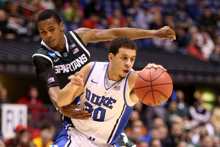 Duke's Seth Curry attempts to drive past Keith Appling of Michigan State during the Midwest Region Semifinal round of the 2013 NCAA Men's Basketball Tournament on March 29, 2013 in Indianapolis, Indiana. (Andy Lyons/Getty Images)