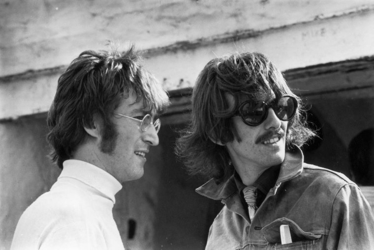 A blue plaque has been unveiled in London to John Lennon and George Harrison of The Beatles. The ceremony on 17th March 2013, was held at 94 Baker Street, which was the site of the now defunct Apple Boutique clothing store. 1967: Beatles John Lennon (1940 - 1980) and George Harrison (1943 - 2001) in Newquay while filming 'The Magical Mystery Tour'. (Keystone Features/Getty Images)