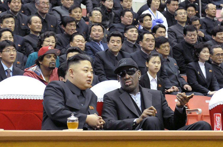North Korean leader Kim Jong-Un (front L) and former NBA star Dennis Rodman (front R) speaking at a basketball game in Pyongyang in this February 28, 2013 photo released by North Korea's official Korean Central News Agency (KCNA) on March 1, 2013. Flamboyant former NBA star Dennis Rodman has become the most high-profile American to meet the new leader of North Korea, vowing eternal friendship with Kim Jong-Un at a basketball game in Pyongyang. (KCNA/AFP/Getty Images)