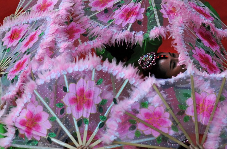 A Chinese dancer performs a traditional dance during an event organised by the Chinese Consulate of the People's Republic of China and Indo-China Promotion Council, in Kolkata. (Dibyangshu Sarkar/AFP/Getty Images)