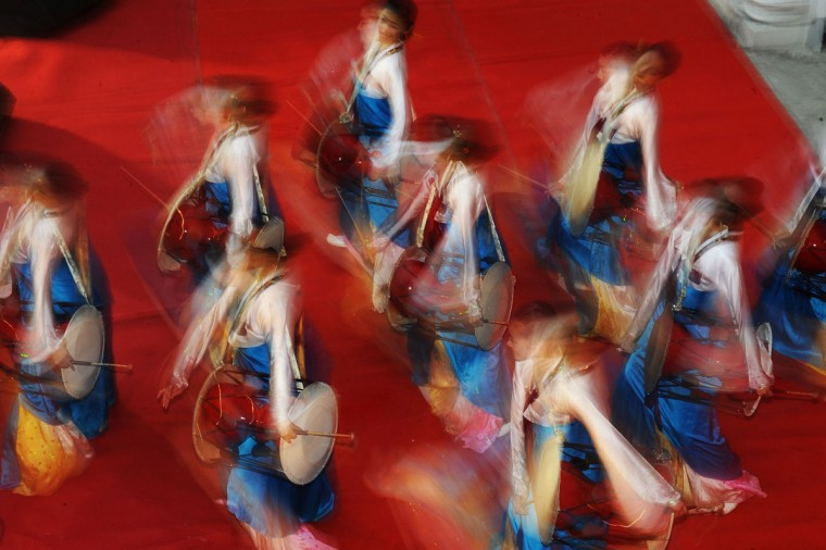 Chinese dancers perform a traditional dance during an event organised by the Chinese Consulate of the People's Republic of China and Indo-China Promotion Council, in Kolkata. The event was organised to create synergy which would not only benifit the two trading partners but also to foster peaceful development among these two global emerging economies in Asia. (Dibyangshu Sarkar/AFP/Getty Images)