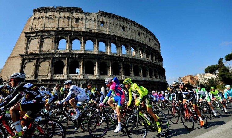 "Cyclists ride past the Colosseum as they take part in the ""Roma Maxima"" cycling race on March 3, 2013 in Rome. (Tiziana Fabi/AFP/Getty Images)"