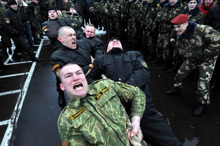 Belarus soldiers from an Interior Ministry special unit compete in a tug-of-war during a military show marking Maslenitsa holiday on the outskirts of Minsk on March 3, 2013. Maslenitsa is an medieval pagan festival that celebrates the end of winter and the start of spring. (Victor Drachev/AFP/Getty Images)