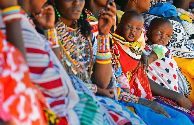 Maasai mothers hold their babies as they queue to vote in Saikeri, Kajiado County, Maasailand, on March 4, 2013 during the nationwide elections. (Carl de Souza/AFP/Getty Images)