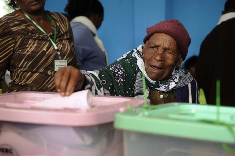 A Kenyan man casts his vote on March 4, 2013 at the Mutomo primary school in Kiambu. Long lines of Kenyans queued from way before dawn to vote Monday in the first election since the violence-wracked polls five years ago, with a deadly police ambush hours before polling started marring the key ballot. (Simon Maina/AFP/Getty Images)