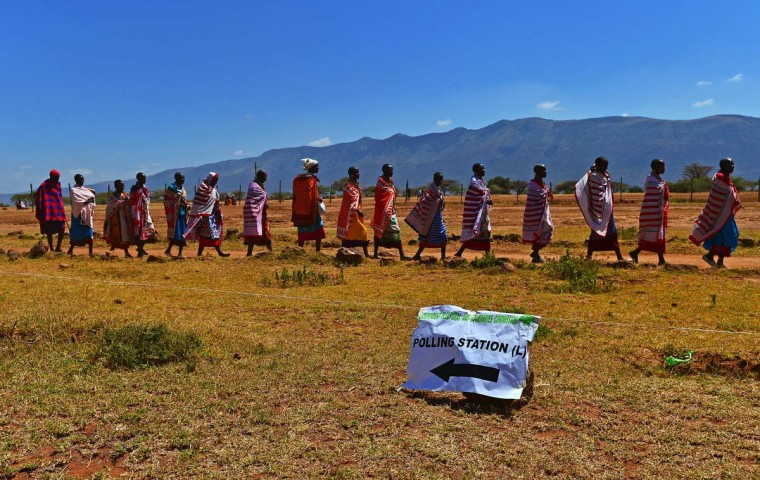 Maasai tribes-people leave after voting in Ilngarooj, Kajiado South County, Maasailand, on March 4, 2013 during Kenya's elections. (Carl de Souza/AFP/Getty Images)