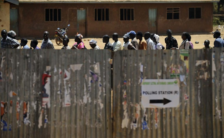People make queue to vote at a polling centre as voting kicked off in Kenya on March 4, 2013 in the country's western province in Kakamega during the nationwide elections. (Tony Karumba/AFP/Getty Images)