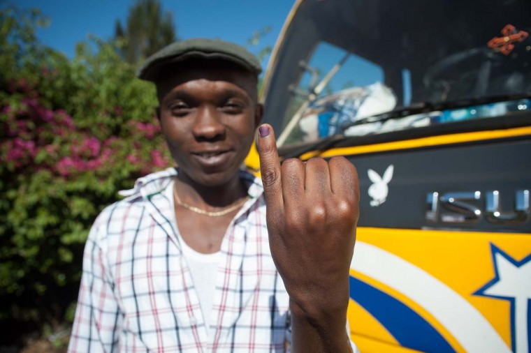 A man shows his inked finger, which marks that he has voted in Kangemi, Nairobi, on March 4, 2013 as Kenyans vote in a general election. (Will Boase/AFP/Getty Images)