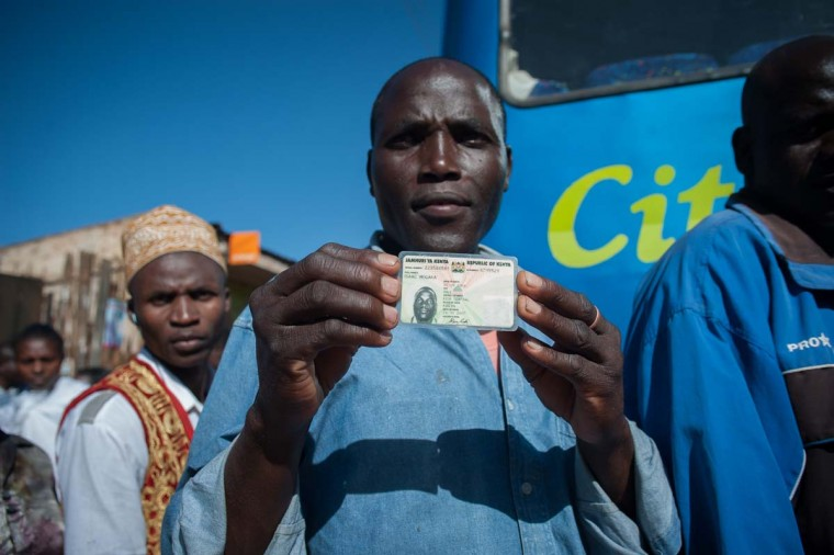 Isaac Mogaka shows his identity card as he stands in line to vote in Kangemi, on March 4, 2013 as Kenyans vote in a general election. (Will Boase/AFP/Getty Images)