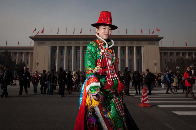 A delegate from an ethnic minority leaves the Great Hall of the People following the opening session of the National People's Congress (NPC) in Beijing on March 5, 2013. Thousands of delegates from across China were meeting this week to seal a power transfer to new leaders whose first months running the Communist Party have pumped up expectations with a deluge of propaganda. (Ed Jones/AFP/Getty Images)