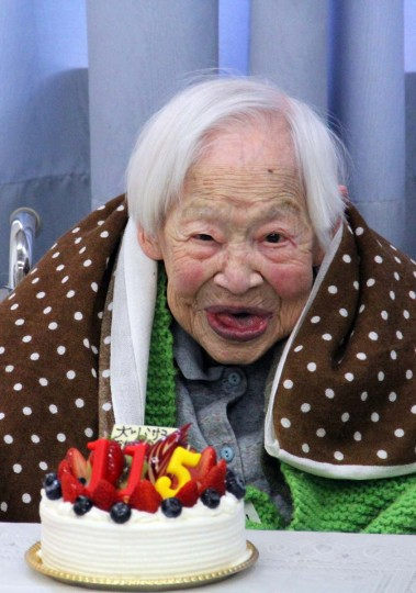 This handout picture taken by Tomohito Okada from the Kurenai nursing home on March 5, 2013 shows the world's oldest woman Misao Okawa celebrating her 115th birthday at the nursing home in Osaka, western Japan. Okawa, who late last month received a certificate from Guinness World Records confirming her status as the oldest living woman, celebrated her 115th birthday on March 5 in a Japanese nursing home with her favourite mackerel sushi dish on the menu. (AFP/Getty Images)